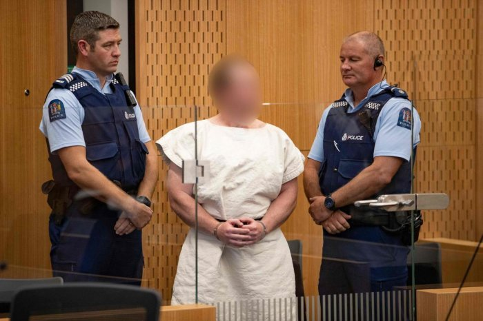 Brenton Tarrant, the man charged in relation to the Christchurch massacre appear in the dock charged with murder in the Christchurch District Court on March 16, 2019. - A right-wing extremist who filmed himself rampaging through two mosques in the quiet N