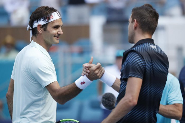 Mar 25, 2019; Miami Gardens, FL, USA; Roger Federer of Switzerland (L) shakes hands with Filip Krajinovic of Serbia (R) after their match in the third round of the Miami Open at Miami Open Tennis Complex. Mandatory Credit: Geoff Burke-USA TODAY Sports