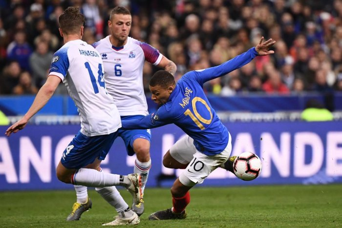 France's forward Kylian Mbappe (R) vies for the ball with Iceland's players during the UEFA Euro 2020 Group H qualification football match between France and Iceland at the Stade de France stadium in Saint-Denis, north of Paris, on March 25, 2019. (Photo