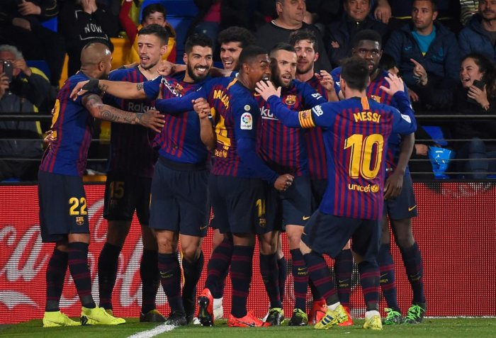 DRAMATIC FINISH: Barcelona players celebrate after Luis Suarez scored a 93rd-minute equaliser against Villarreal on Tuesday. AFP