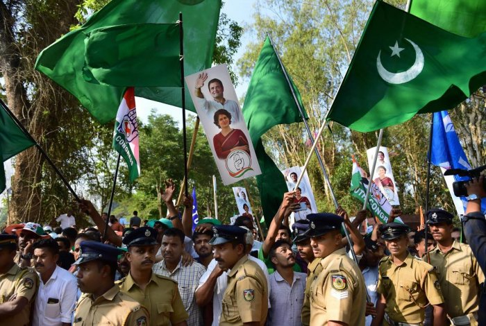 Indian Union Muslim League (IUML) supporters, with green flags, join supporters of Congress as they wave flags prior to the filing of nomination papers by Congress President Rahul Gandhi, in Wayanad on Thursday. PTI