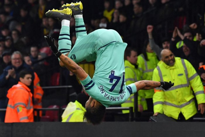 FLIPPIN OVER: Arsenal's Pierre-Emerick Aubameyang celebrates in acrobatic fashion after scoring against Watford on Monday. AFP
