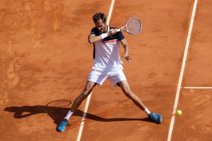 IN CONTROL: Russia's Daniil Medvedev hits a return to Serbia's Novak Djokovic during their quarterfinal at the Monte Carlo Masters on Friday. AFP