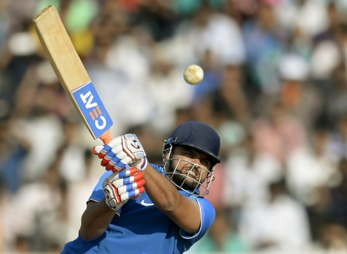 Raina returns to T20 squad