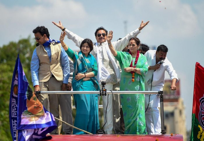 Samajwadi Party candidate from Lucknow Poonam Sinha with party MP Dimple Yadav and Congress candidate from Patna Sahib husband Shatrughan Sinha during a roadshow enroute filing her nomination papers, in Lucknow, Thursday, April 18, 2019. (PTI Photo)