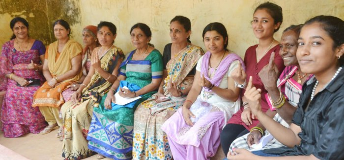 Women voters show inked fingers after casting their votes in the Maoist-infested Vanachalu polling booth in Madikeri taluk on Thursday. DH photo