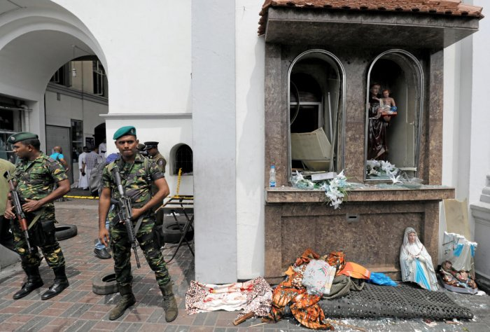 Sri Lankan military officials stand guard in front of the St. Anthony's Shrine, Kochchikade church after an explosion in Colombo. Reuters photo