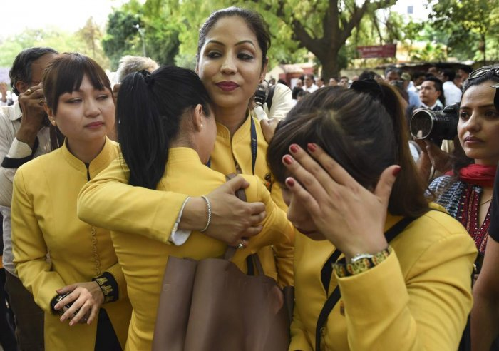 A Jet Airways employee cries as they gather to make an appeal to save the airline after it announced temporary suspension of flight operations, in New Delhi, Thursday, April 18, 2019. (PTI Photo)