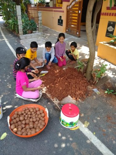 Children preparing seed balls to be planted in Turahalli forest. DH photo