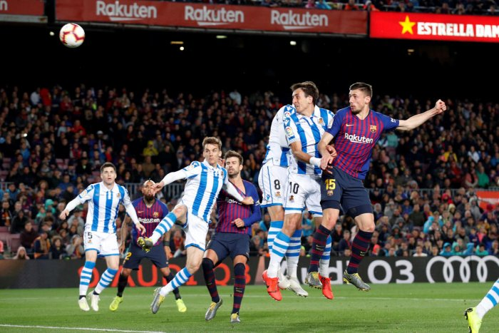 POWERED HOME: Barcelona's Clement Lenglet (right) scores against Real Sociedad on Saturday. Reuters