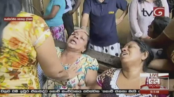 This image made from video, released by Derena TV shows women in despair after an explosion in Colombo, Sunday, April 21, 2019. Witnesses are reporting two explosions have hit two churches in Sri Lanka on Easter Sunday, causing casualties among worshipper