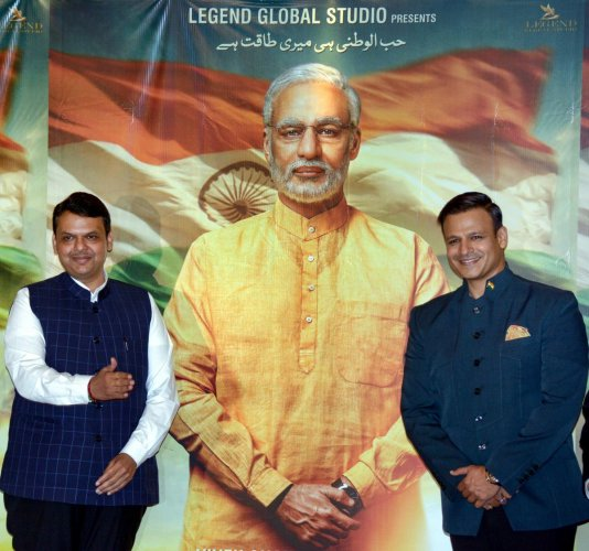 Maharashtra Chief Minister Devendra Fadnavis and Bollywood actor Vivek Oberoi pose for photos after the poster launch of Prime Minister Narendra Modi's biopic. PTI