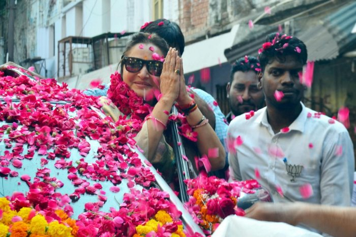 BJP parliamentary candidate from Rampur, Jaya Prada, greets party workers during an election rally ahead of the Lok Sabha elections. (PTI Photo)
