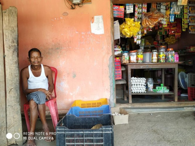 50-year old Aitu Solam sitting in front of his shop at his house in Salwa Judum camp, Dornapal, Sukma.