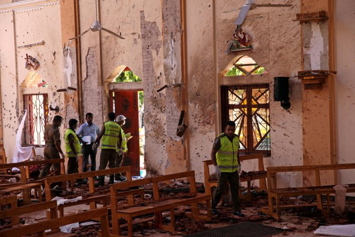 Police officers work at the scene at St. Sebastian Catholic Church, after bomb blasts ripped through churches and luxury hotels on Easter, in Negombo, Sri Lanka. (Reuters Photo)
