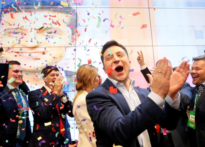 Ukrainian presidential candidate Volodymyr Zelenskiy reacts following the announcement of the first exit poll in a presidential election at his campaign headquarters in Kiev, Ukraine. (Reuters Photo)