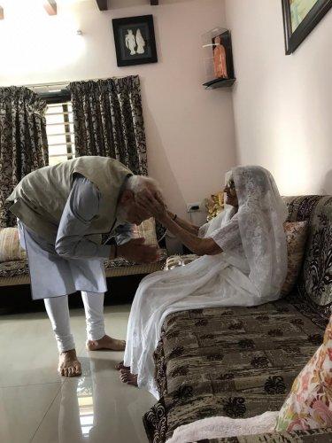 Mother Hiraben Modi blessing Prime Minister Narendra Modi at her residence in Ahmedabad on Tuesday. (Twitter/BJP)