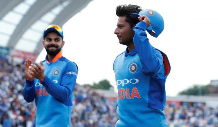 Kuldeep Yadav with Virat Kohli at the end of the innings. Reuters Photo