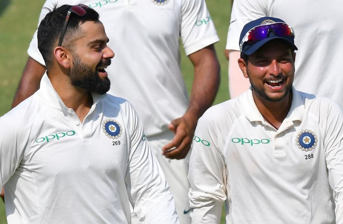 FAST LEARNER: Chinaman bowler Kuldeep Yadav (right) could be a potent weapon for skipper Virat Kohli when India travel to Australia at the end of the year. AFP