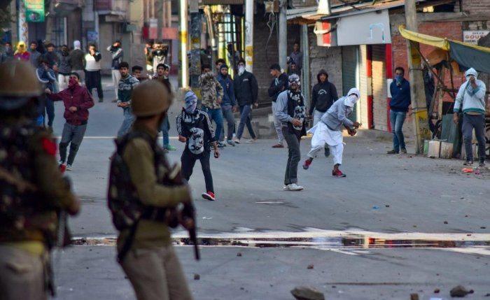 Srinagar: Protesters pelt stones at the police during a clash, in Srinagar in this dated filed photo. The protest was over the death of seven civilians in the Kulgam blast. (PTI Photo Oct 21, 2018) (PTI10_22_2018_000123B)