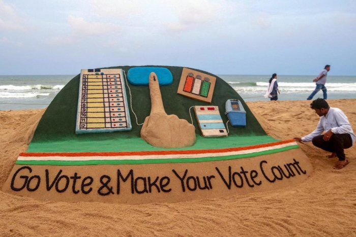 """Renowned sand artist Sudarsan Pattnaik creates a sand sculpture on voting awareness with message """"Go vote & make your vote count"""", at Puri beach of Odisha, Monday, April 22, 2019. (PTI Photo)"""