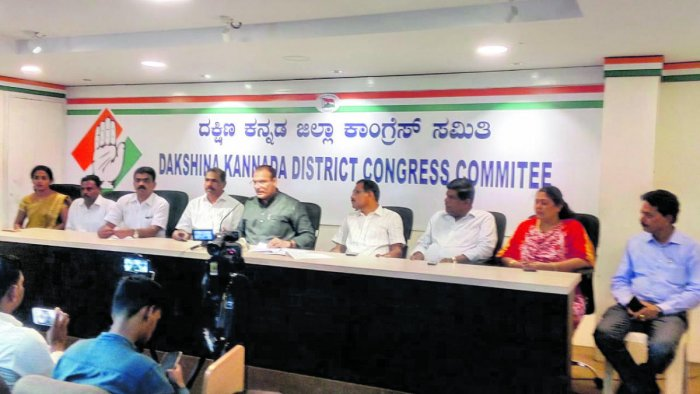 Ivan D'Souza, MLC and parliamentary secretary to the chief minister, speaks to reporters in Mangaluru on Monday.