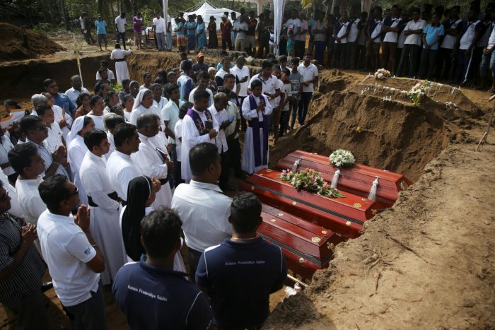 People attend a mass burial of victims, two days after a string of suicide bomb attacks on churches and luxury hotels across the island on Easter Sunday, at a cemetery near St. Sebastian Church in Negombo, Sri Lanka April 23, 2019. (REUTERS)