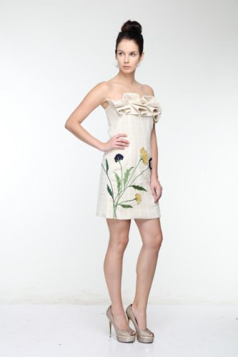 In Vogue Hand-made floral embroidery on a short dress.