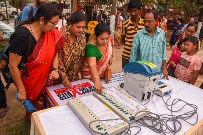 Poll officials aware people EVM (Electronic Voting Machine) and Voter Verified Paper Audit Trial (VVPAT) machine at a camp in Guwahati on April 13, 2019. (PTI Photo)