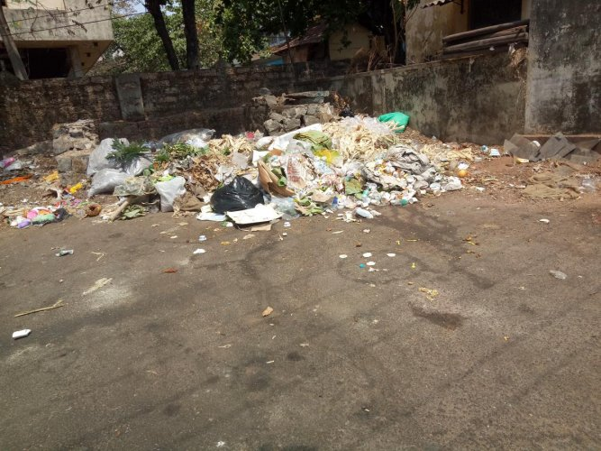 Garbage left unattended to in one of the localities in Mangaluru on Tuesday.