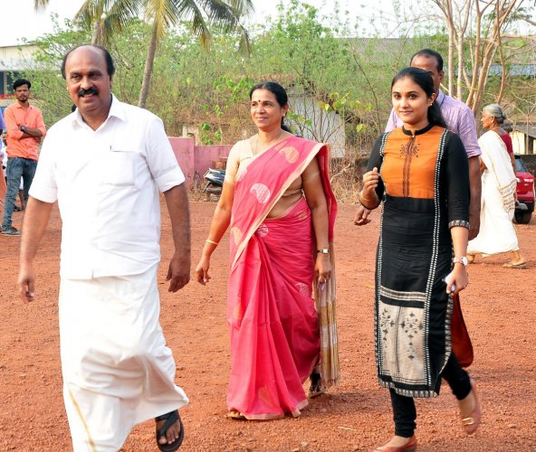Revenue Minister E Chandrashekaran arrives along with his family members to the polling booth to exercise franchise.