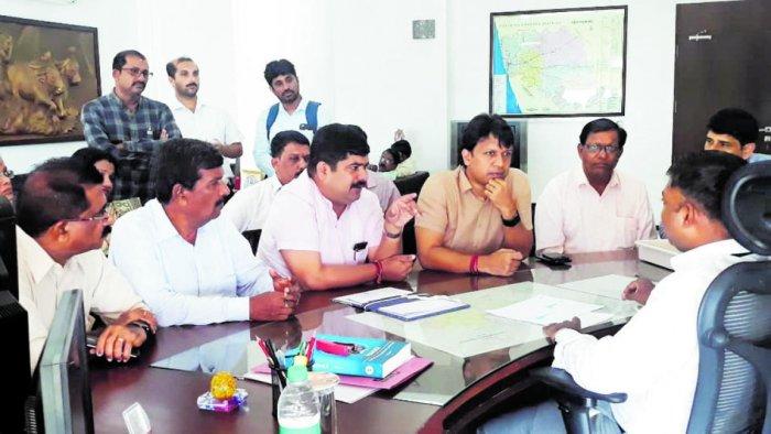 MLAs D Vedavyas Kamath and Dr Y Bharath Shetty speak to Deputy Commissioner Sasikanth Senthil, in Mangaluru on Tuesday.