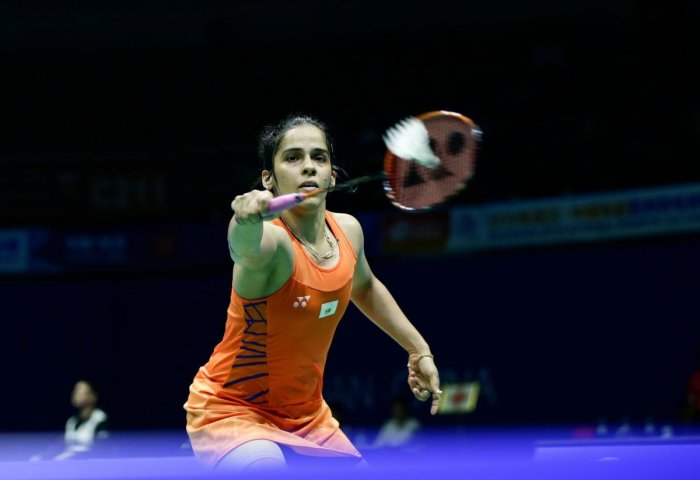 GUTSY: India's Saina Nehwal returns during her hard-fought win over Han Yue of China in the first round of the Asia Badminton Championship in Wuhan on Wednesday. AFP