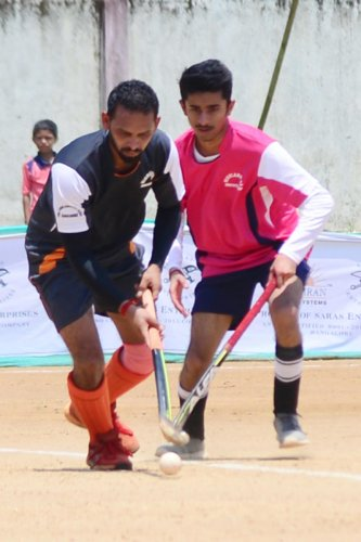 Players of Mandeera and Channapanda in action at the hockey tournament organised by The Highlanders Family Club at General K S Thimayya Stadium in Napoklu on Wednesday.