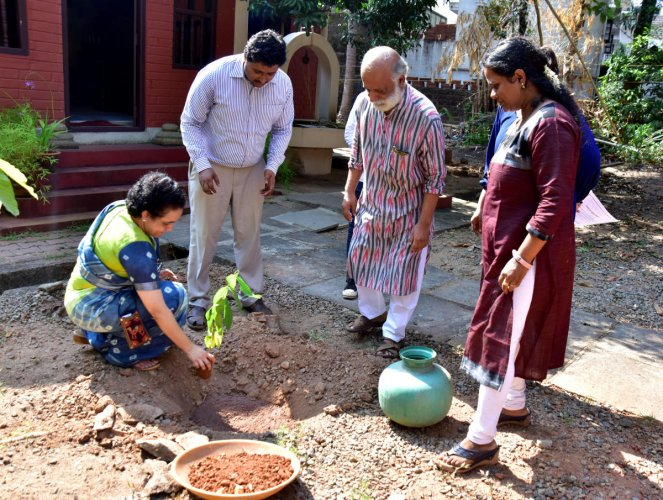 Nitte University Center of Science and Research Professor Dr Smitha Hegde plants a sapling on the premises of Guttu House in Kodialbail, Mangaluru, on the occasion of 'Ila 2019', organised on the lines of World Earth Day, by Nitte Institute of Communication.