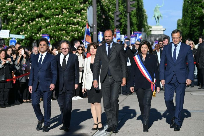 French Prime Minister Edouard Philippe (C), flanked by co-presidents of the Coordination Council of Armenian organisations of France (CCAF), Mourad Franck Papazian (L) and Ara Toranian (2nd L), Mayor of Paris Anne Hidalgo (2nd from R) and president of the