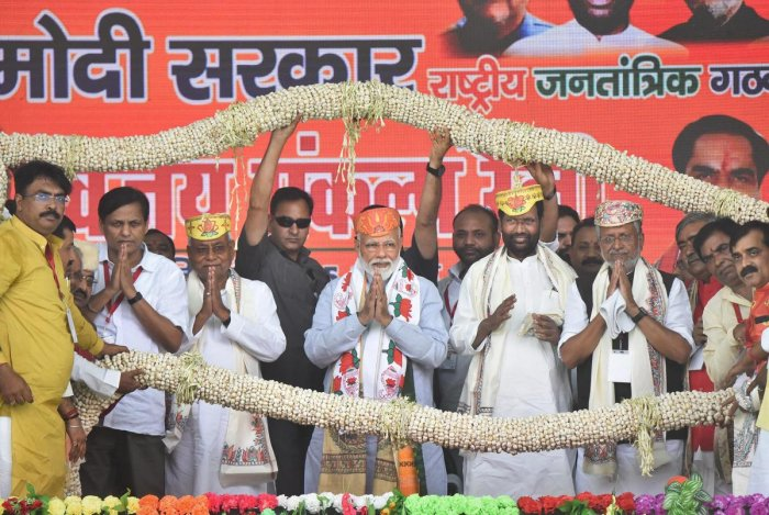 Prime Minister Narendra Modi is being garlanded along with Bihar Chief Minister and Janta Dal-United President Nitish Kumar, his deputy Sushil Kumar Modi, Lok Janshakti Party (LJP) chief Ram Vilas Paswan and others, during an election rally ahead of the L
