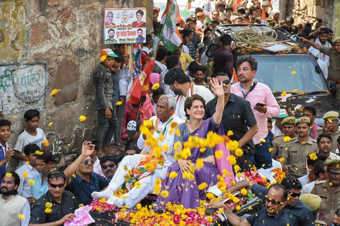 Congress General Secretary Priyanka Gandhi Vadra waves at the supporters during an election rally in support of the party candidate Shiv Sharan Kushwaha (to Priyanka's right), in Jhansi on Thursday. PTI