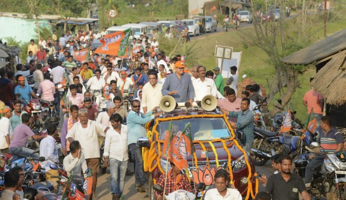 BJP parliamentary candidate Baijayant Panda waves at party workers during an election campaign roadshow for Lok Sabha polls, in Kendrapada district, Tuesday, April 16, 2019. (PTI Photo)