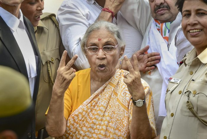 DPCC President Sheila Dikshit flashes the victory sign as she leaves after filing her nomination papers from North East Delhi parliamentary seat, in New Delhi, Tuesday, April 23, 2019.