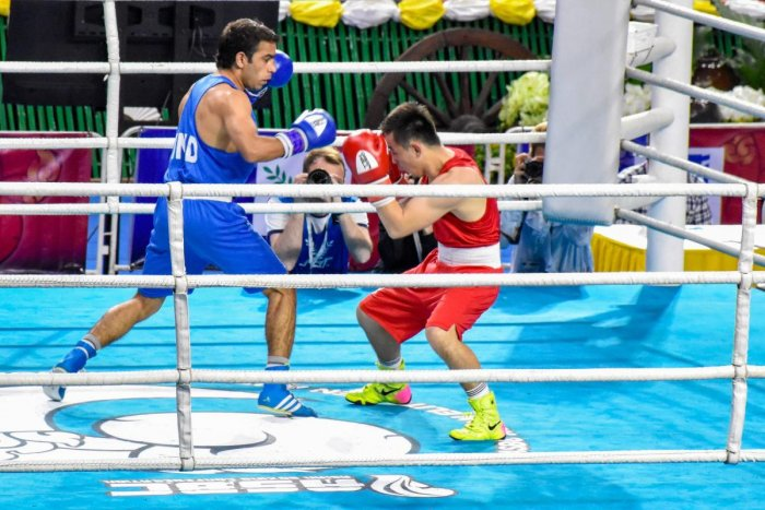 India's Amit Panghal in action against Olympic champion Hasanboy Dusmatov, at the Asian Boxing Championships in Bangkok, Monday, April 22, 2019. PTI