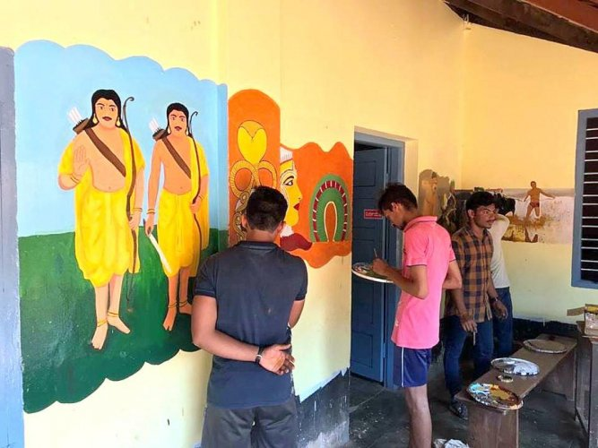 Artistes adore the walls of Government Primary School, Kairangala, Bantwal with the paintings depicting the culture of Tulunadu.