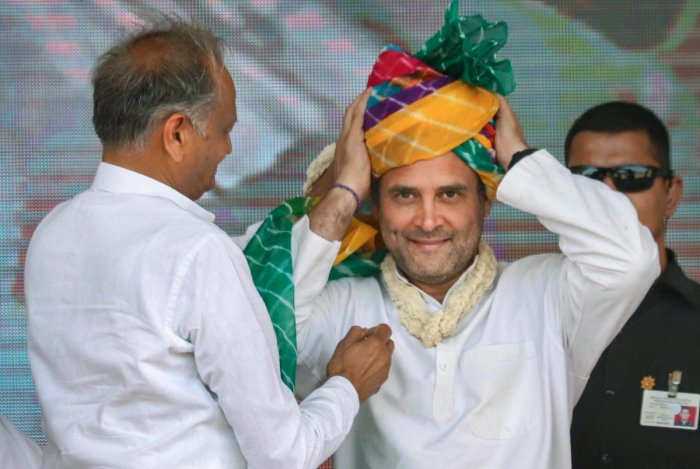 Congress President Rahul Gandhi being presented a turban by Rajasthan Chief Minister Ashok Gehlot during the election campaign rally at Bandanwara in Ajmer district on Thursday. PTI