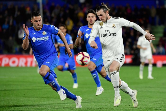 UNDERWHELMING: Real Madrid's Gareth Bale (right) was far from his best as his team was held to a 0-0 draw by Getafe. AFP