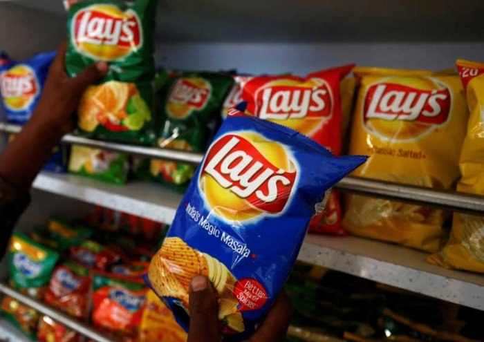 """The All India Kisan Sabha (AIKS), the Centre for Indian Trade Union (CITU) and the All India Ambedkar Maha Sabha (AIAMS) on Friday called for a boycott of PepsiCo's potato products, including the popular brand 'Lays', till the multinational company withdraws cases filed against farmers for allegedly growing a variety of potato """"registered"""" by the company. (Reuters Photo)"""
