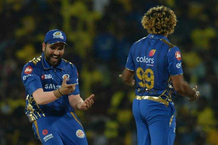 Mumbai Indian's Rohit Sharma (left) and Lasith Malinga celebrate the dismissal of Chennai Super Kings' Shane Watson in Chennai on Friday. AFP