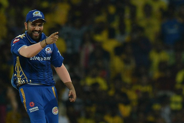 Mumbai Indians cricket captain Rohit Sharma (L) celebrates a wicket of Chennai Super Kings. (AFP Photo)