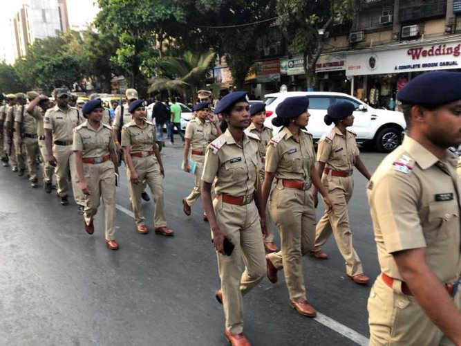 Police personnel conduct a route march in Thane district ahead of polling day. (DH Photo)