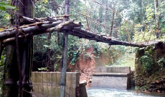 The incomplete work on a bridge near Kothnadka has forced the residents to use the hanging wooden bridge.