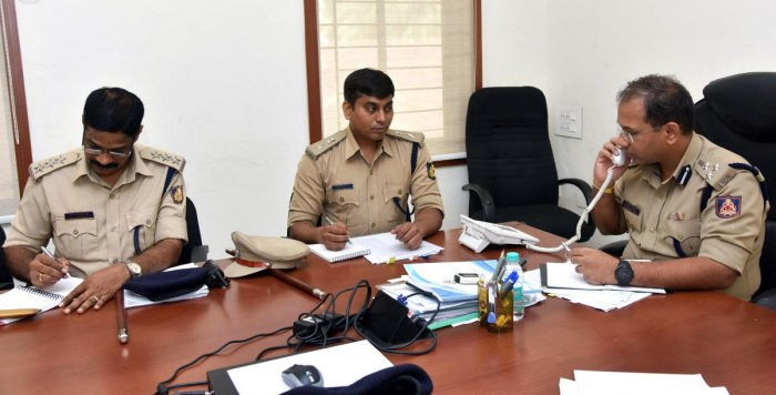 Mangaluru City Police Commissioner Sandeep Patil receives a complaint during the weekly phone-in programme held on Friday.
